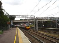 A recent build 11 car Virgin Pendolino races south through Lichfield Trent Valley Low Level station on 31 July. Up above, a London Midland 323 EMU is about to depart the High Level platform on the 12.50 service to Longbridge. <br><br>[David Pesterfield&nbsp;31/07/2012]