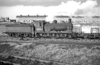 J36 0-6-0 no 65346 of Bathgate shed shunting the sidings at Addiewell in 1961. This short goods branch was opened by the NB in 1869 to serve Addiewell Oil Works and finally closed in 1963. Little remains of this scene today (2012) although, while Livingstone Street (running across the centre of the picture) was demolished in 1967, the house on the left still survives as part of Addiewell Farm buildings.<br><br>[Frank Spaven Collection (Courtesy David Spaven)&nbsp;//1961]