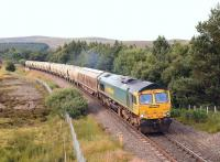 The Inverness - Oxwellmains cement empties heading south near Tomatin on 2 August behind Freightliner 66614.<br><br>[John Gray&nbsp;02/08/2012]