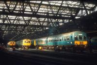Sunlight pierces the gloom at Leith Central in 1972, by which time the old station had been closed for 20 years and was in use as a diesel servicing facility. Leith Central was allocated a shed code of 64H. [See image 27361]<br><br>[Bill Roberton&nbsp;//1972]