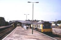 Platform scene at St Erth in August 1995. A Penzance - Plymouth service stands at the main line platform with the St Ives branch train in the bay.<br><br>[Ian Dinmore&nbsp;/08/1995]