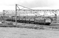 76 051 with a train of empties passing Penistone on 17 July 1981 heading for Rotherwod Sidings. In the background are Barnsley Junction sidings which contain a rake of MGR coal empties (probably destined for Dodworth colliery) and 76 022 on a Sheffield bound train of scrap.<br><br>[Bill Jamieson&nbsp;17/07/1981]