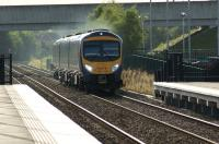 Approaching Buckshaw Parkway station on 4 August 2012, First TransPennine 185145 heads for Manchester Airport.<br><br>[John McIntyre&nbsp;04/08/2012]