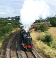 Climbing away from Farington Curve Junction on 8 August, ex-LNER K4 no 61994 <I>The Great Marquess</I> hauls the 12 coach 'Fellsman' railtour round the long curve before heading east towards Blackburn and on to Carlisle.<br><br>[John McIntyre&nbsp;08/08/2012]
