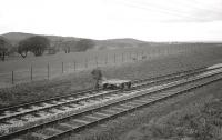 One man and his shovel. A member of the PW team involved in reballasting work on the Largs branch between West Kilbride and Fairlie on Easter Sunday 1963. <br><br>[R Sillitto/A Renfrew Collection (Courtesy Bruce McCartney)&nbsp;14/04/1963]