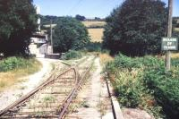 Entrance to the clay dries at Moorswater, Cornwall, in August 1989. View is north, with Coombe Junction behind the camera [see image 17767]. Running straight ahead is the stub of a line which once served a number of mines and quarries in the surrounding area. This line closed to all traffic in 1916. <br><br>[Ian Dinmore&nbsp;/08/1989]