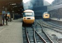 An InterCity 125 HST stands at Newcastle Central in 1981, flanked by a pair of class 40 locomotives.<br><br>[Colin Alexander&nbsp;//1981]