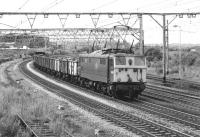 After being held in the loop at Barnsley Junction, 76022 now heads towards Sheffield with a load of scrap in unbraked 16T mineral wagons. The train is the 12.00 from Dewsnap Sidings on 17 July 1981, reporting No. 8E11 [with thanks to Rob Barnes].<br><br>[Bill Jamieson&nbsp;17/07/1981]