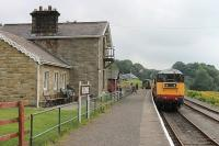 EE Type 1 20166 pulls in to Redmire station with a Wensleydale Railway service that originated at Leyburn and will now form the first departure, the 10.10hrs to Leeming Bar. The station building has been extended (or should that be restored) in recent years and now appears to be used as holiday acocmmodation or a hostel. [See image 37234] for an earlier view of the same location.<br><br>[Mark Bartlett&nbsp;12/08/2012]