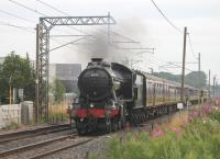 <I>The Great Marquess</I> was used for the <I>The Fellsman</I> service for a third consecutive week on 15th August. 61994 is seen here at the site of Brock station on the outward leg of the journey and is just passing over the only remaining foot crossing between Lancaster and Preston.<br><br>[Mark Bartlett&nbsp;15/08/2012]
