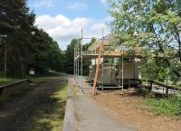 A bit of TLC being applied to the signalbox at Knockando in July 2012. The station building, behind the camera, has already been renovated [See image 39004]. View west towards Blacksboat.<br><br>[Mark Bartlett&nbsp;05/07/2012]