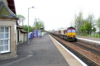 EWS 66225 brings a coal train through West Calder station on a May morning in 2005 heading in the Edinburgh direction. <br><br>[John Furnevel&nbsp;01/05/2005]