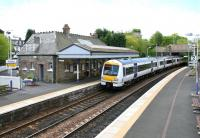 Platform view at Aberdour station looking south in May 2005 with a train leaving for Waverley.<br><br>[John Furnevel&nbsp;05/05/2005]