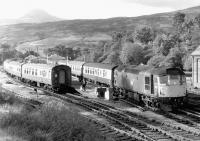 BRCW Type 2 5357 on a Fort William - Glasgow Queen Street working crossing a northbound service at Crianlarich in the summer of 1971. The train crews are in the process of swapping over.<br><br>[John Furnevel&nbsp;29/06/1971]