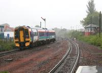 Leaving Larbert Station northbound during a rainstorm in May 2005.<br><br>[John Furnevel&nbsp;/05/2005]