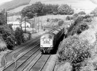 A class 40 hauled southbound train passing Auldgirth signal box in October 1970. Auldgirth station (closed 1952) stands in the left background alongside the bridge.<br><br>[John Furnevel&nbsp;18/10/1970]