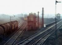 Scene at Dentonholme North Junction on the Carlisle goods lines in December 1969, as D411 and D5179 pass with freights in the fog. <br><br>[John Furnevel&nbsp;17/12/1969]