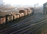 As the sun begins to break through the fog a mixed freight trundles south past Dentonholme North box on the Carlisle goods lines in 1969. Meantime, on the other side of the former Viaduct Yard, with track now lifted, an up express is about to enter Citadel station.<br><br>[John Furnevel&nbsp;17/12/1969]
