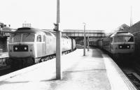 View back towards the main station from the south end of platform 1 at Dundee in September 1981. 47119 waits in the bay with a Dundee - Glasgow Queen Street service while 47160 calls at platform 1 with an Aberdeen - Birmingham train.<br><br>[John Furnevel&nbsp;25/09/1981]