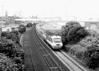 The down <I>'Aberdonian'</I> InterCity HST continues its journey north following the Dundee stop on 5 August 1981. The train is seen here shortly after passing Camperdown Junction with the dock estate to the left and the A92 road running parallel with the line on the right.<br><br>[John Furnevel&nbsp;05/08/1981]