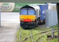Asda containers at WHM Grangemouth on 13 June 2005, recently arrived behind DRS 66446.<br><br>[John Furnevel&nbsp;13/06/2005]