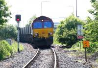 EWS 66078 approaching Seafield level crossing out of the sun with coal empties from Cockenzie power station heading back to Leith Docks on 9 June 2005.<br><br>[John Furnevel&nbsp;09/06/2005]