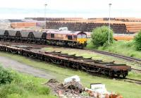 Coal empties and steel pipe flats at Leith South yard on 9 June 2005 with one or two of said steel pipes forming the backdrop. <br><br>[John Furnevel&nbsp;09/06/2005]