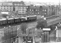 25026 has just passed the site of Gorgie East station on the Edinburgh 'sub' with a northbound freight on 14 April 1981. The train is about to cross the bridge over Gorgie Road before taking the left fork at Gorgie Junction to join the E&G main line at Haymarket West.<br><br>[John Furnevel&nbsp;14/04/1981]