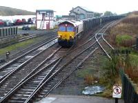 A Drax - Kirkby Thore gypsum train approaching Kirkby Stephen through the rain on 29 October 2004, approximately 18 miles short of its destination.<br><br>[John Furnevel&nbsp;29/10/2004]