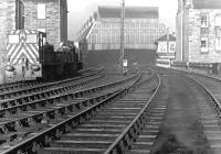 View west towards Leith Central station on the far side of Easter Road in March 1970. The station was in use as a diesel depot at the time (64H) and two of its allocation (D2435 and D2413) stand in the sidings on the left. The tenement block that originally stood here was demolished in 1901 to make way for the bridge across Easter Road into the station.<br><br>[John Furnevel&nbsp;12/03/1970]