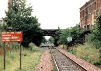 Looking towards Powderhall and the 'destructor' from the west end of the former Leith Walk station on a Sunday morning in August 1999. Part of the abandoned Shrubhill tram depot stands on the right.<br><br>[John Furnevel&nbsp;15/08/1999]