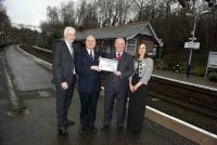 The platform presentation of the Platinum award at Whitecraigs station on 5 January 2012. [Left to right Steve Montgomery, Gary MacIntyre, Derek Robertson and Elaine Bell] [See news item].<br><br>[First ScotRail&nbsp;05/01/2012]