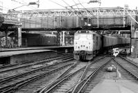 Parcels train arriving at Liverpool Street in July 1980 behind a class 31. The 37 in the background has recently been released and is waiting for the road back to Stratford diesel depot.<br><br>[John Furnevel&nbsp;08/07/1980]