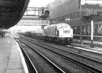 Eastbound freight through Manchester Victoria in November 1970. Platform 11, Britains longest railway platform, is on the left and the east end of Exchange station (closed the previous year) can be seen in the left background. <br><br>[John Furnevel&nbsp;20/11/1970]