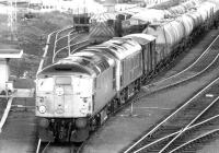 Freight for the north leaving Millerhill down yard in November 1972 behind a pair of type 2 locomotives.<br><br>[John Furnevel&nbsp;03/11/1972]