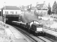 Clayton 8582 with a westbound freight passing Morningside Road station on the Edinburgh <I>sub</I> in July 1971.<br><br>[John Furnevel&nbsp;20/07/1971]