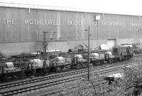 Shunting sidings alongside Motherwell Bridge and the WCML in October 1970. The Motherwell Bridge sidings were beyond the fence. [See image 56105]<br><br>[John Furnevel&nbsp;30/10/1970]