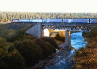 The Inverness portion of the Caledonian Sleeper catches the morning sun as it crosses Carrbridge Viaduct over the River Dulnain on 12 September 2004.<br><br>[John Furnevel&nbsp;12/09/2004]