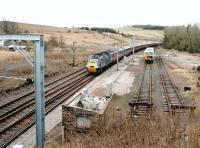 The site of the former station at Grantshouse, Berwickshire, seen here in March 2004. Grantshouse station closed to passengers in 1964 and nowadays the cleared site provides ECML access and stabling facilities for maintenance and engineering staff. The passing train is the GNER Inverness - Kings Cross <I>Highland Chieftain</I><br><br>[John Furnevel&nbsp;16/03/2004]