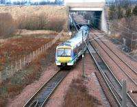 A train entering the reversing siding at the north end of Millerhill in December 2003 after terminating at Newcraighall station (platform just visible under bridge) with a service from Bathgate.<br><br>[John Furnevel&nbsp;02/12/2003]