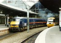 The west end of Newcastle Central in April 1997. On the left a GNER service has recently arrived from Kings Cross, while on the right an HST in BR InterCity livery is awaiting departure time with a Birmingham train.<br><br>[John Furnevel&nbsp;05/04/1997]
