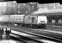 A Hymek leaving Paddington with a train for Worcester and Hereford, taken from Royal Oak Metropolitan Line station in May 1969. Part of Paddington's large parcels depot, with its dedicated platform, stand in the background.<br><br>[John Furnevel&nbsp;05/05/1969]