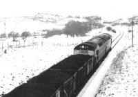 A coal train nearing the village of Patna in the winter of 1971 on its way from Waterside to Ayr Harbour.<br><br>[John Furnevel&nbsp;01/12/1971]