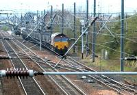 A coal train has just turned off the ECML after passing through Prestonpans station in April 2002 and is currently standing on the line into Cockenzie power station (the up platform at Prestonpans can be seen in the left background). The train is currently held at signals awaiting clearance to enter the yard.  <br><br>[John Furnevel&nbsp;12/04/2002]