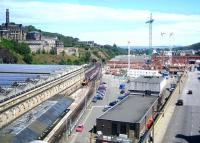 Looking east from the top deck of a bus on North Bridge in June 2005. A Virgin Voyager is approaching platform 20 from the Calton Tunnel with a Cross Country service off the ECML. Phase 1 of the Waverley Valley development is underway between East Market Street and the station - the new Edinburgh Council HQ is starting to take shape, while the soon-to-be-demolished bus depot in New Street still forms the far side of the triangle.<br><br>[F Furnevel&nbsp;01/06/2005]