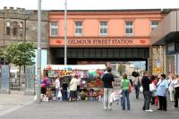 East end of Gilmour Street station on Saturday 30 July 2005 with a colourful street market trader in operation. View is north from County Square.<br><br>[John Furnevel&nbsp;30/07/2005]