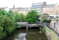 The bridge over the River Kelvin used by the former Glasgow Central Railway, photographed looking south from the roadbridge carrying Great Western Road on 10 July 2005. The platforms of the GCRs Kelvin Bridge station stood on this structure. Eastbound trains arrived via the now bricked up section to the right of the bridge, having run in a tunnel below Great Western Road from Botanic Gardens. [See image 4695]<br><br>[John Furnevel&nbsp;10/07/2005]