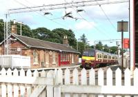 Looking east over the platforms at Cardross from the level crossing in July 2005, with a train for Airdrie about to depart.<br><br>[John Furnevel&nbsp;27/07/2005]
