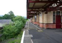 The abandoned through platform with track lifted on the north side of Dumbarton Central in July 2005 looking towards Glasgow. The adjacent platform to the right is currently platform 1.<br><br>[John Furnevel&nbsp;10/07/2005]