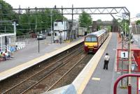 Platform 1 at Dalmuir looking east on 27 July 2005 with a train for Balloch entering the station.<br><br>[John Furnevel&nbsp;27/07/2005]